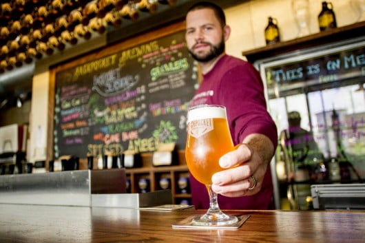Bob Wagner, operations manager at Backpocket Brewing Co. serves an IPA at the brewery in Coralville, IA on Thursday, May 15, 2014. (Photo: Iowa City Press-Citizen file photo)