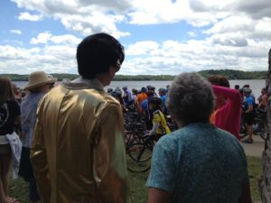 A gold-clad Elvis impersonator was on hand to croon to RAGBRAI participants at the ride-ending tire dip in the Mississippi River in Fort Madison. Michael Morain/The Register